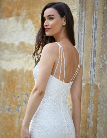 Hendrix - an ornate lace sheath gown with beaded straps
