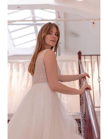 Evita - une robe trapèze super brillante