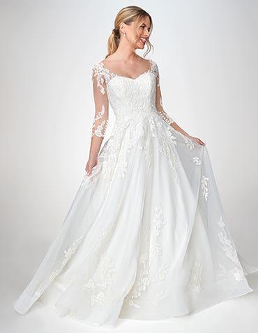Azariah - een gebloemde kanten A-lijn jurk met mouwen