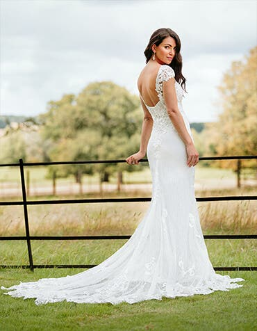 Enzo - an ornate sheath gown with statement train