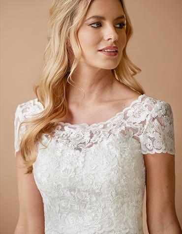JESSAMY - a floral lace cap sleeve jacket