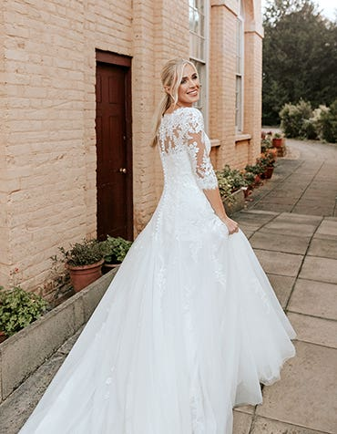 Laurenza - a traditional lace gown with illusion sleeves