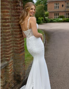Luca - an illusion back crepe gown with statement train