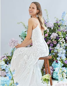 Lyssa - an embroidered gown with statement back