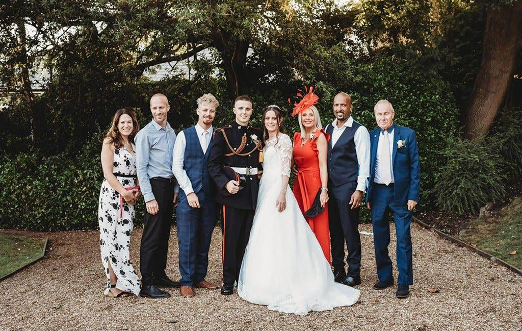 A family group shot at this couples townhouse wedding