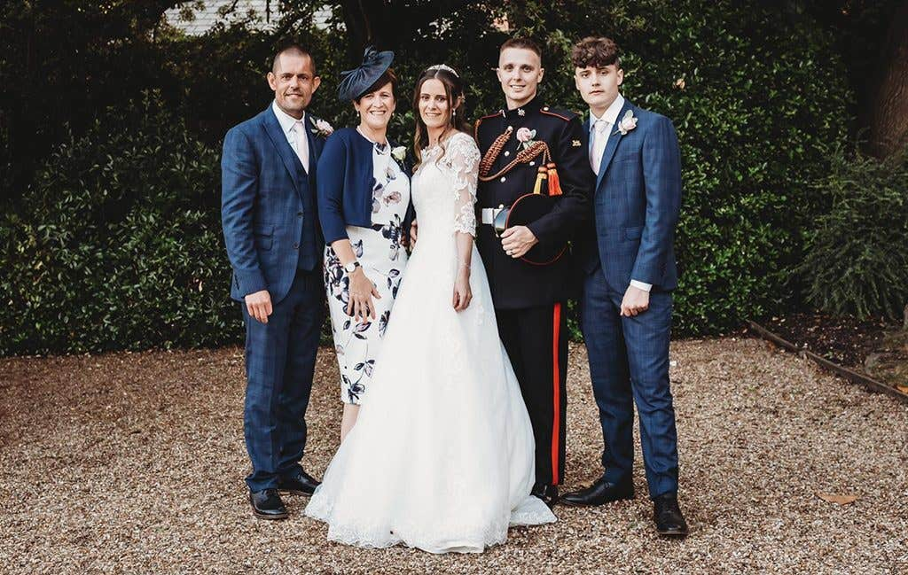 The happy couple and their family at their townhouse wedding