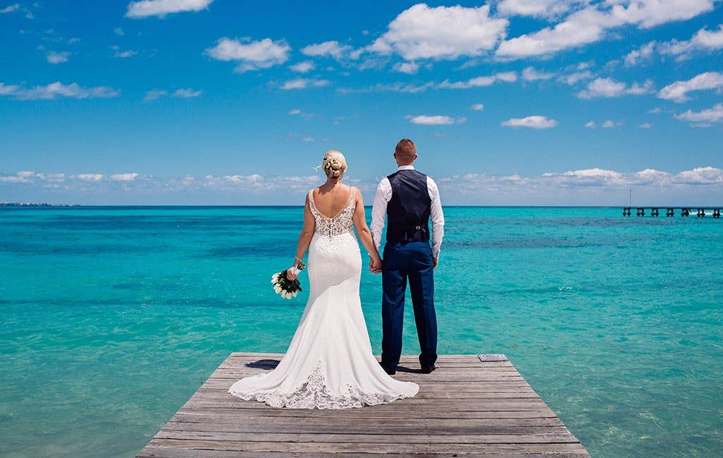 Looking out over the beautiful blue sea while getting married abroad