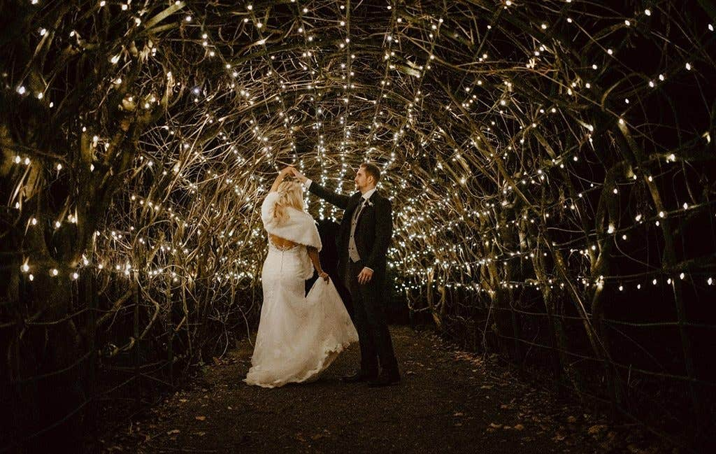 Dancing together at this wedding with a gold wedding theme
