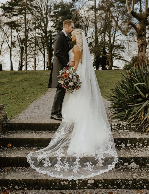The couple enjoying their wedding with a gold wedding theme