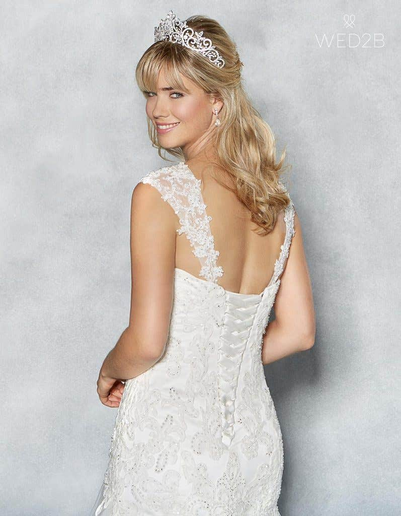 Close-up back view of sweetheart neckline wedding dress Amanie by Viva Bride, with accessories