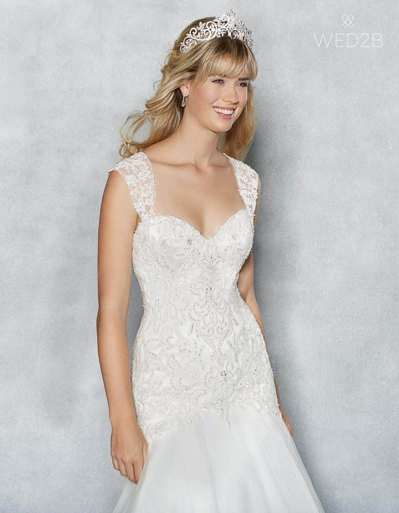 Close-up front view of sweetheart neckline wedding dress Amanie by Viva Bride, with accessories