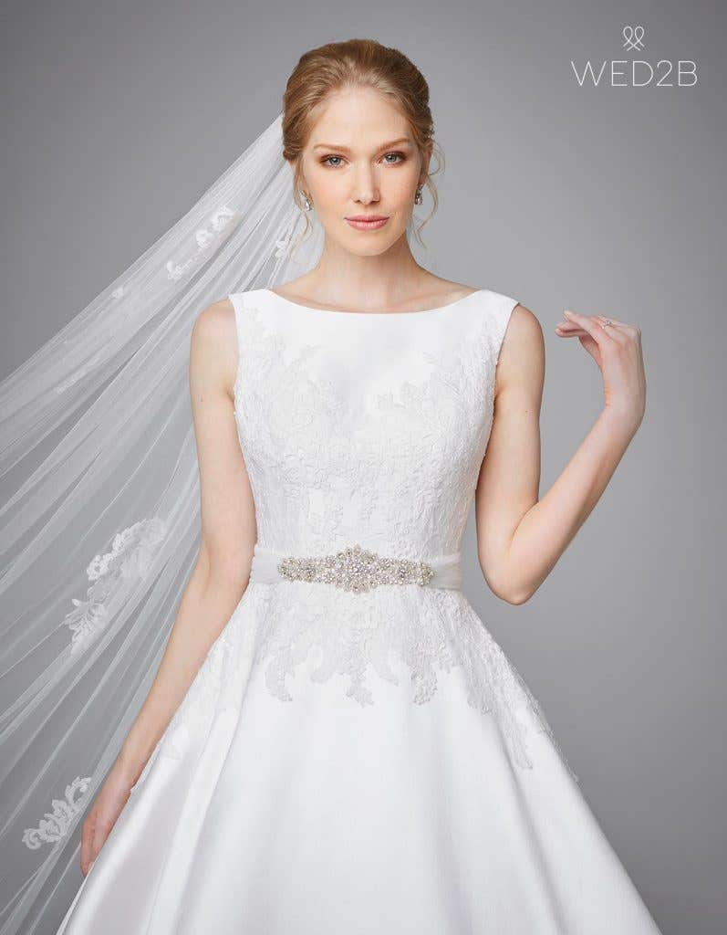 Front view of pleated wedding dress Phillipa by Anna Sorrano with accessories