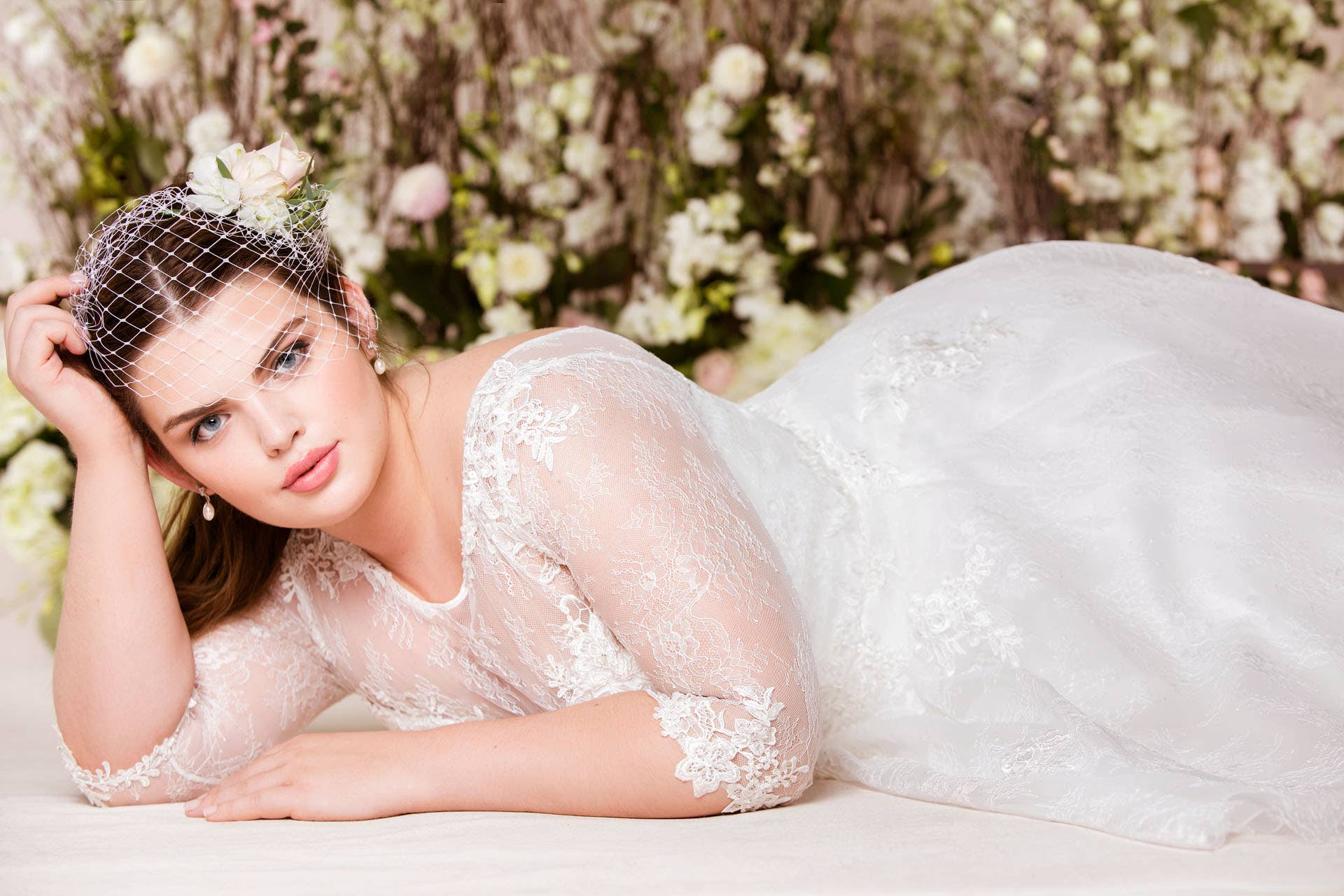 Celebrate your curves with our plus size wedding dresses