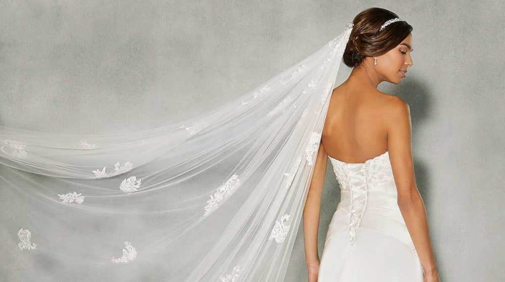We love lace-up wedding dresses!