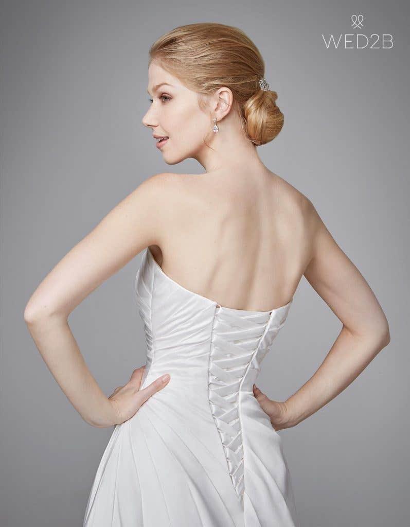 Close-up back shot of bridal dresses Clare