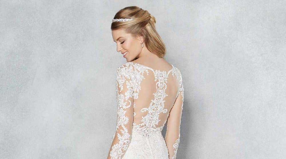 Make a statement with one of these stunning low back wedding gowns