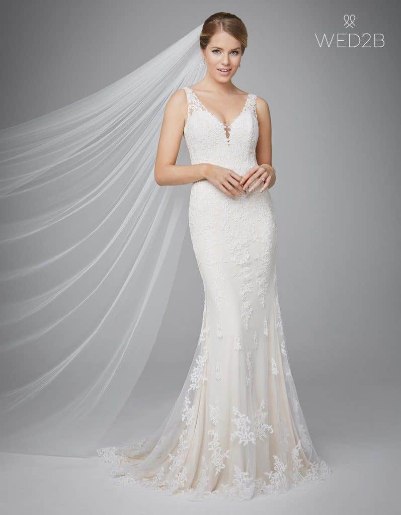 Make a statement with one of these stunning low back wedding gowns - Dara