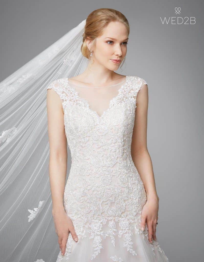 Make a statement with one of these stunning low back wedding gowns - Rosetta