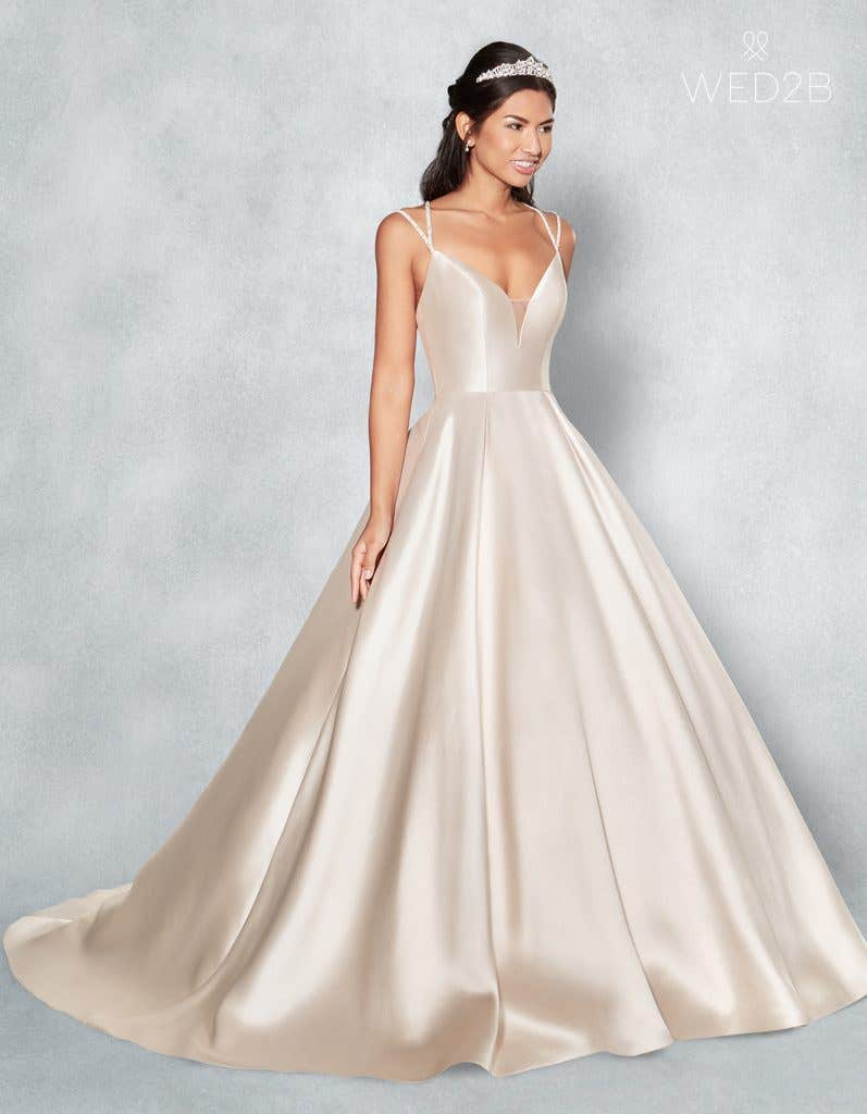Front view of Amber in blush, a princess wedding dress
