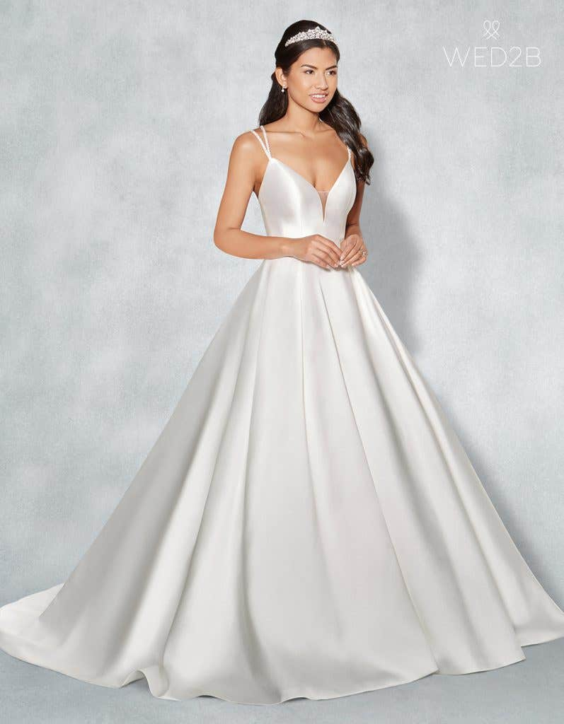 Front view of Amber in ivory, a princess wedding dress