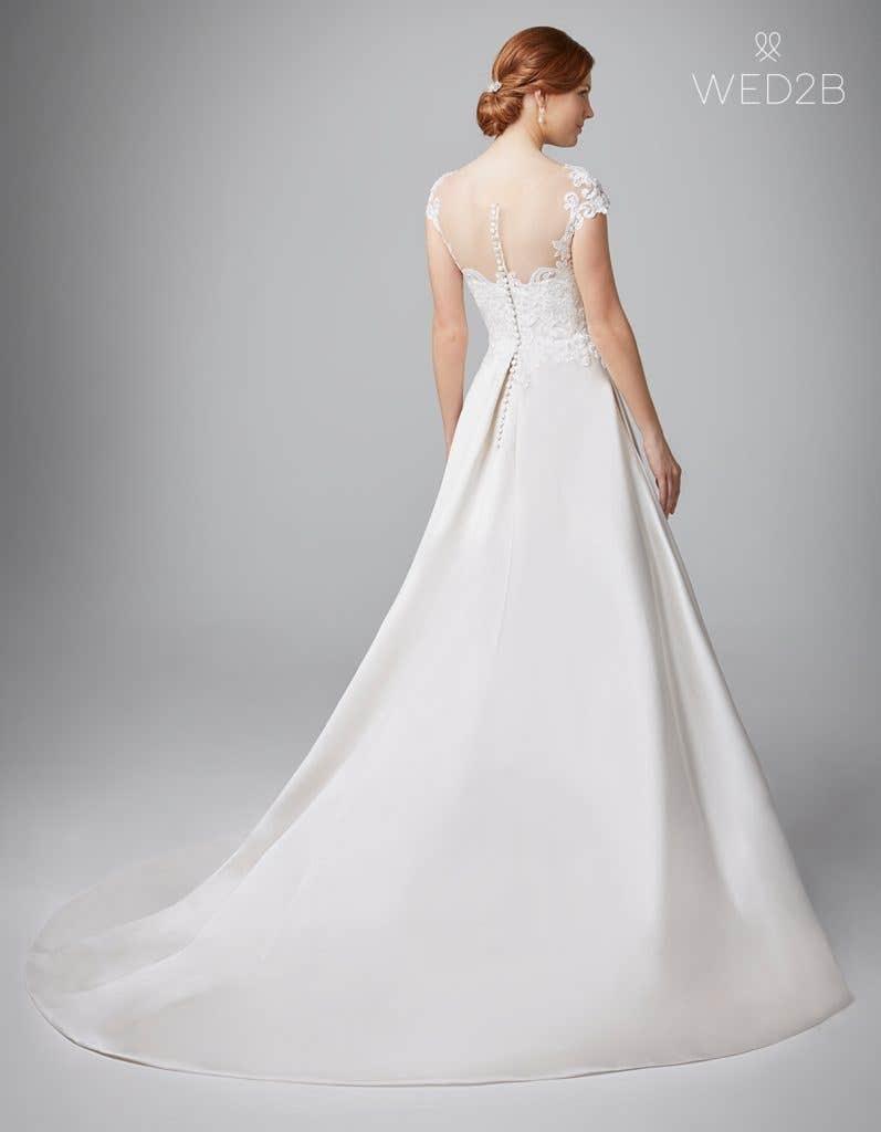 Back view of Dawson in ivory, a princess wedding dress