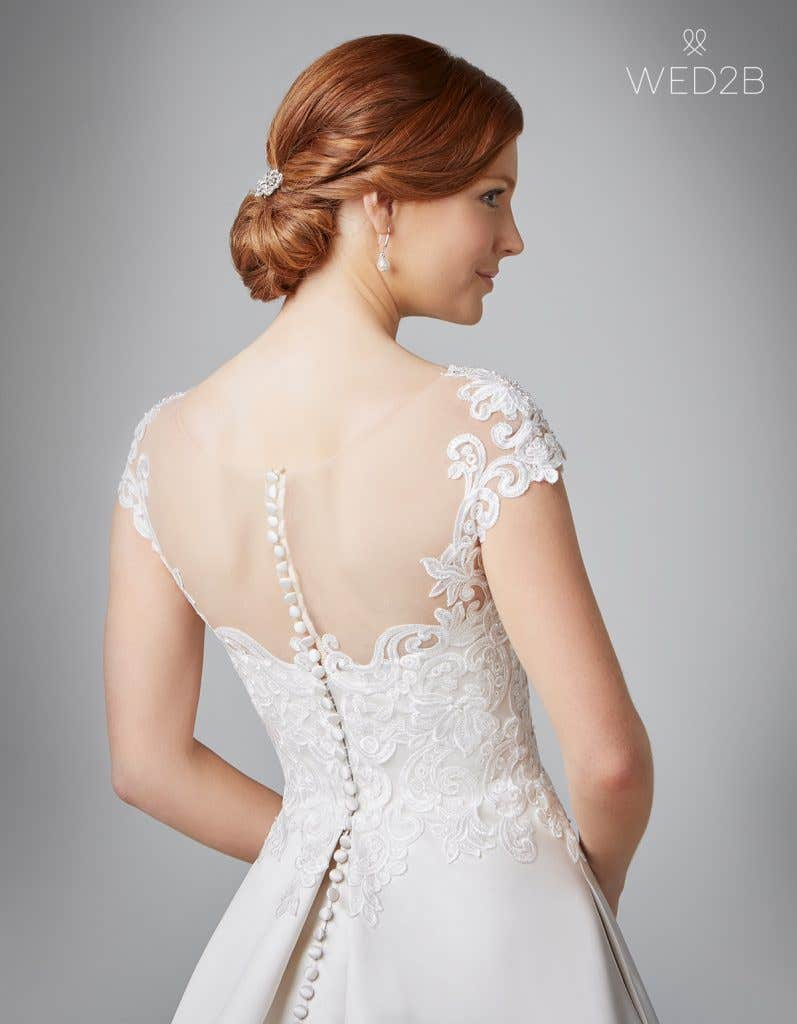 Close-up back view of Dawson in oyster, a princess wedding dress