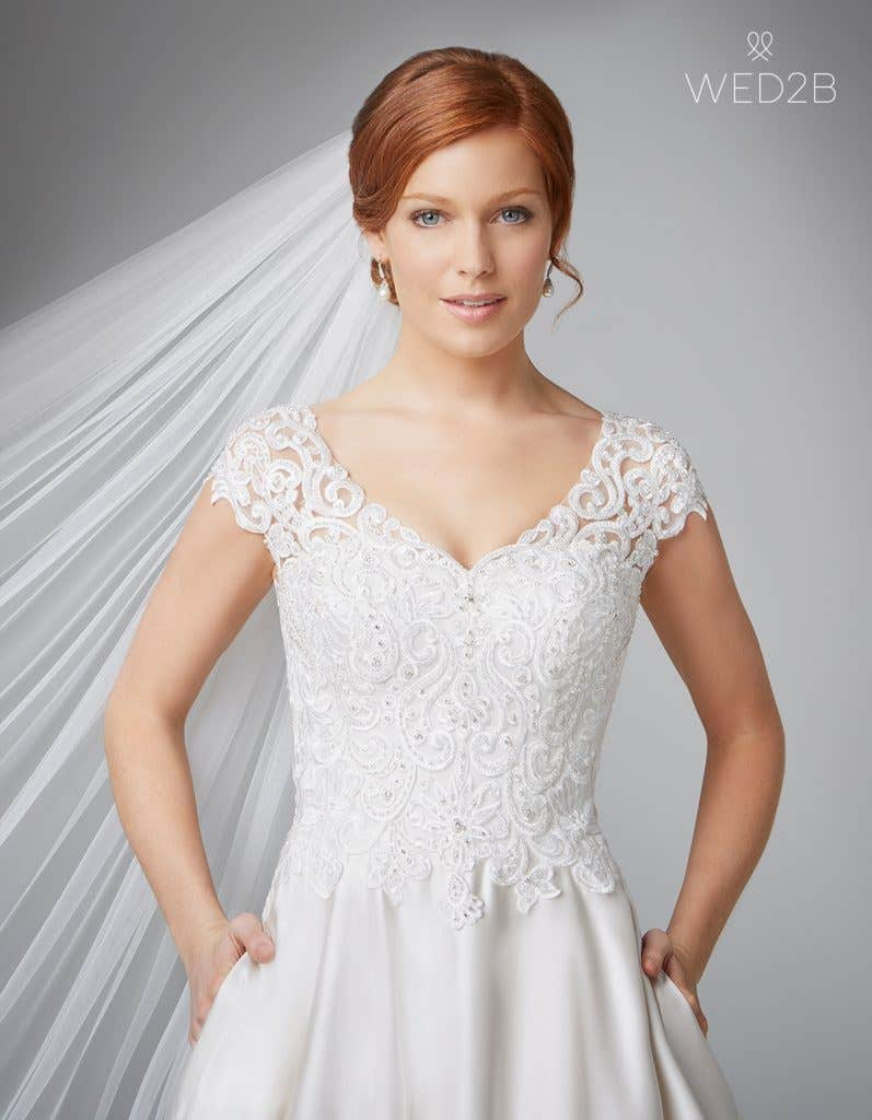 Close-up front view of Dawson in oyster, a princess wedding dress