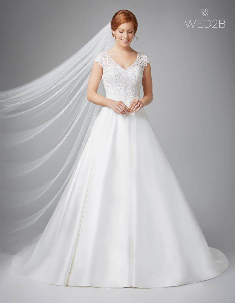 Front view of Dawson in ivory, a princess wedding dress