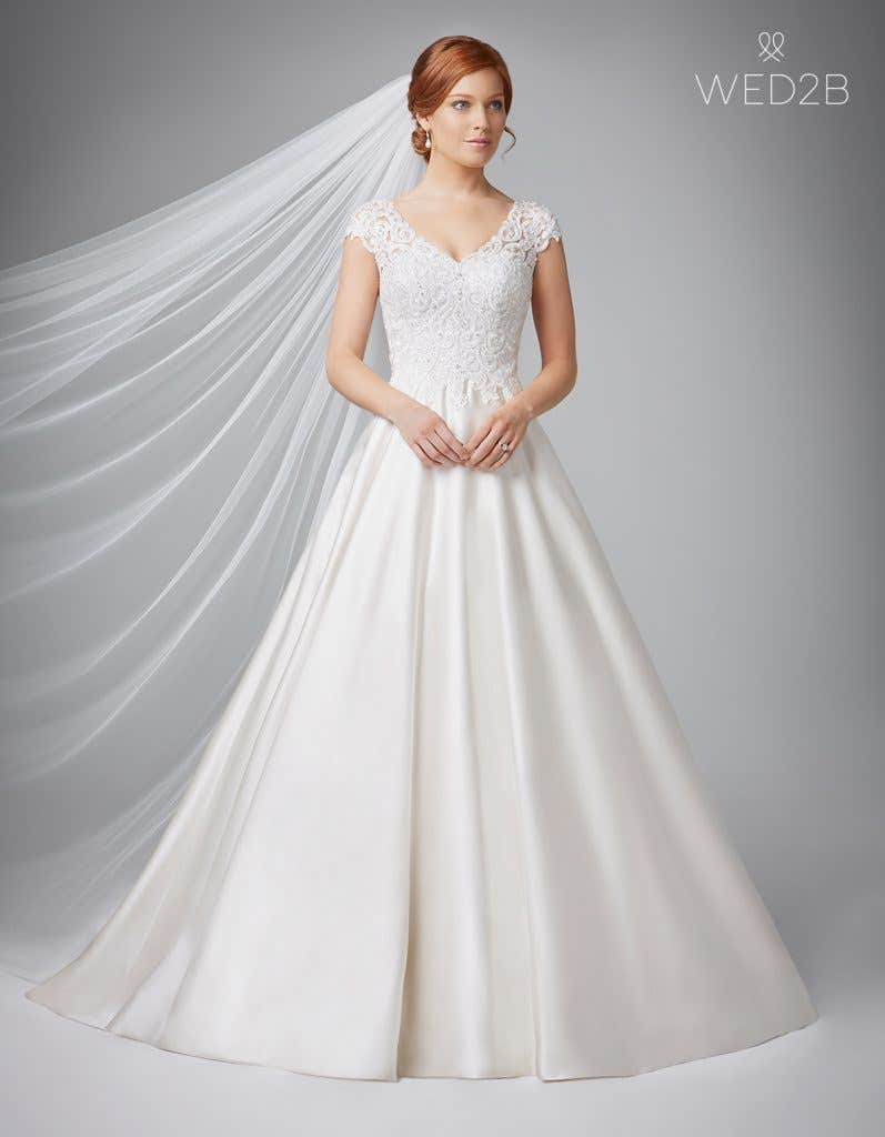 Front view of Dawson in oyster, a princess wedding dress