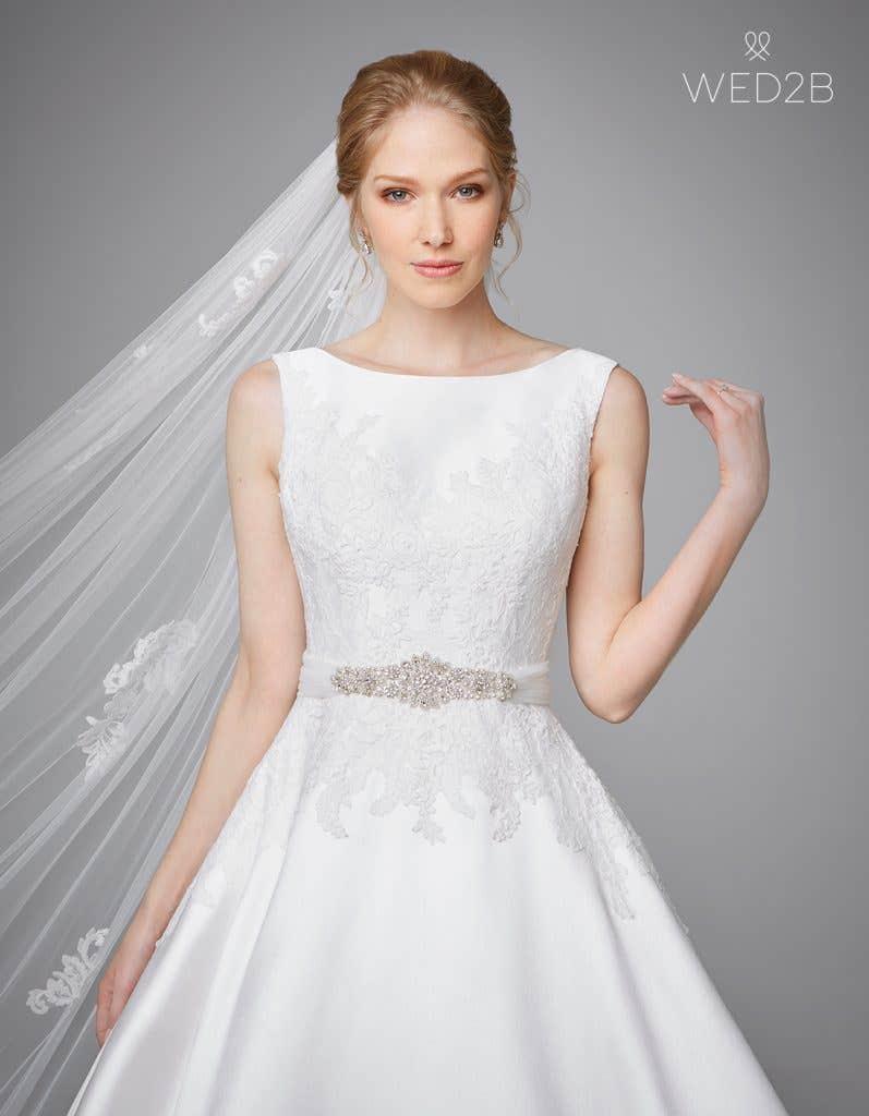 Close-up front view of Phillipa, a princess wedding dress, with bridal belt Nova