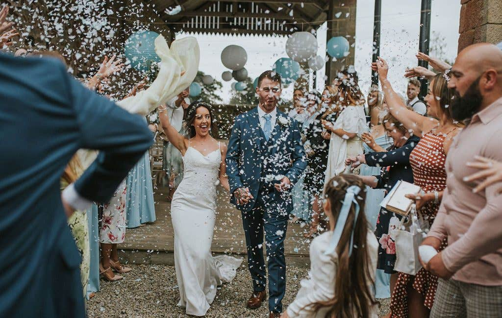 DIY bride Elizabeth and and her husband Conor at the confetti throw
