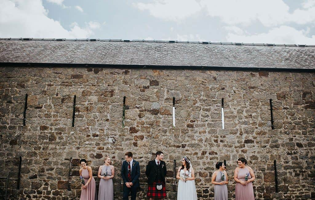 Victoria and Stuart with their bridesmaids for their outdoor wedding