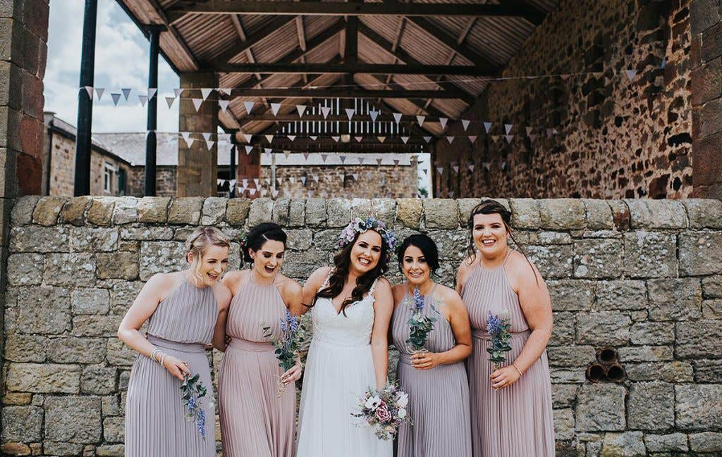 Victoria with her bridesmaids for their outdoor wedding