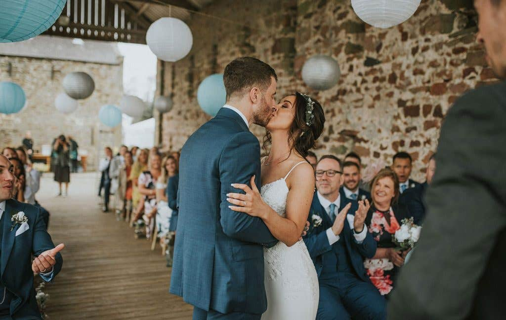 DIY bride Elizabeth and husband Conor kissing after being married