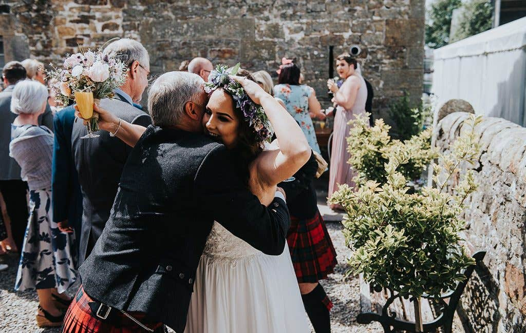 Victoria hugging a guest at her outdoor wedding