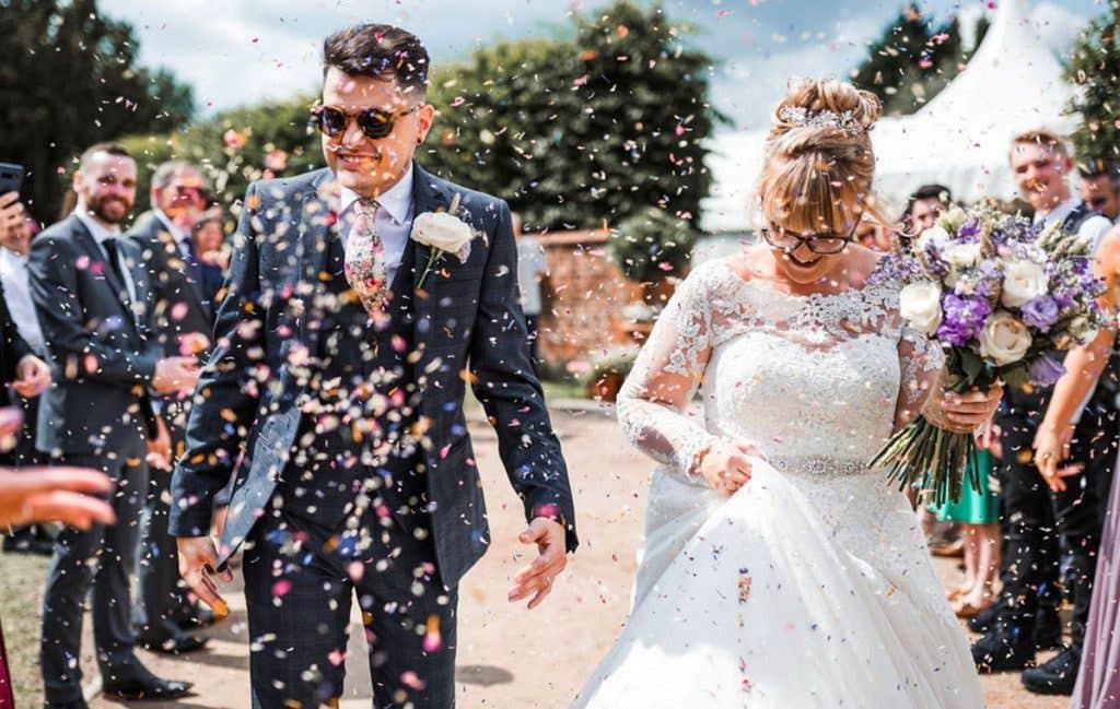 A confetti shot at Melanie and Allan's outside wedding