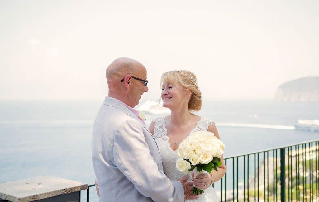 Elizabeth and Mark overlooking the sea at their destination wedding