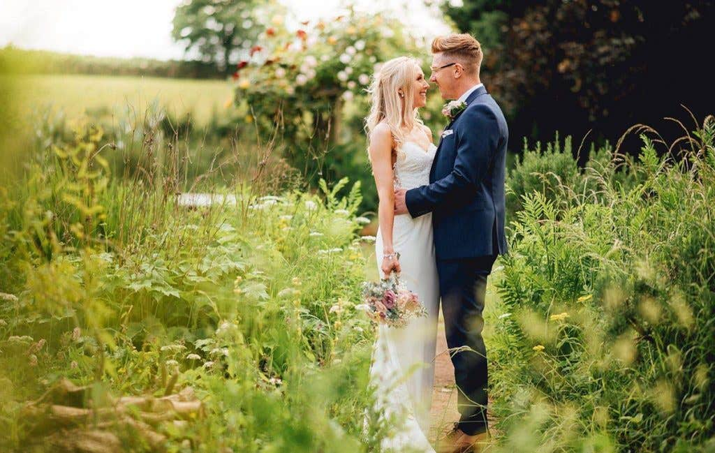 Charlotte and Martin outside on their rustic wedding day