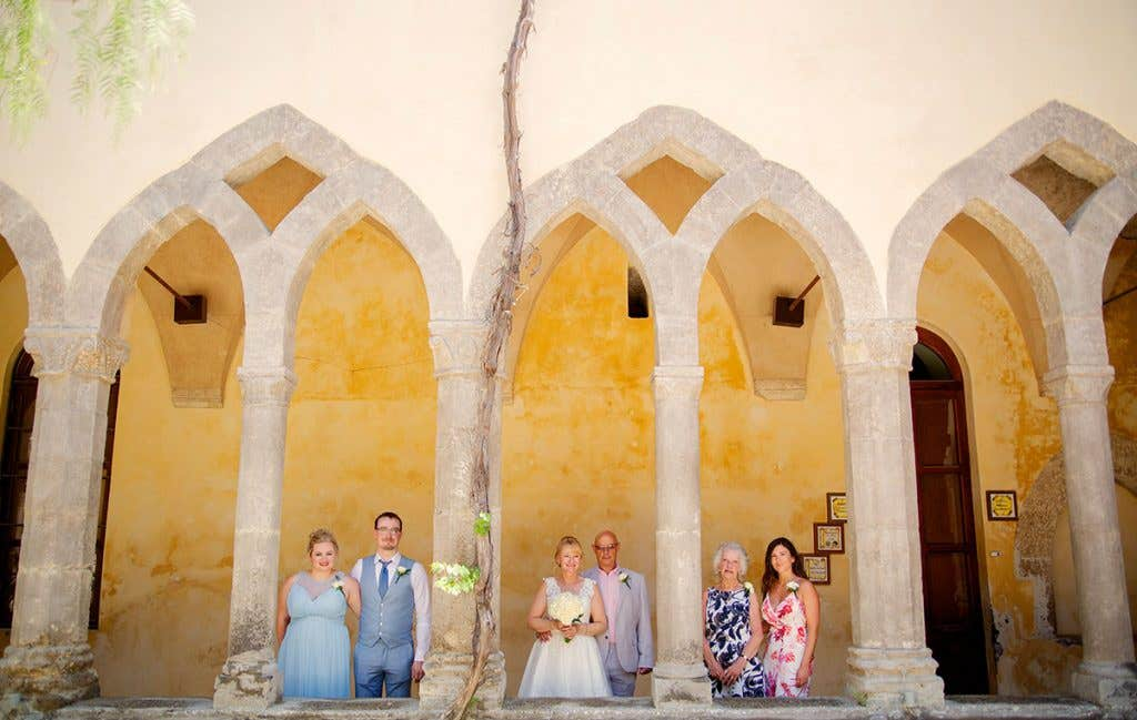 Elizabeth and Mark with their guests at their destination wedding