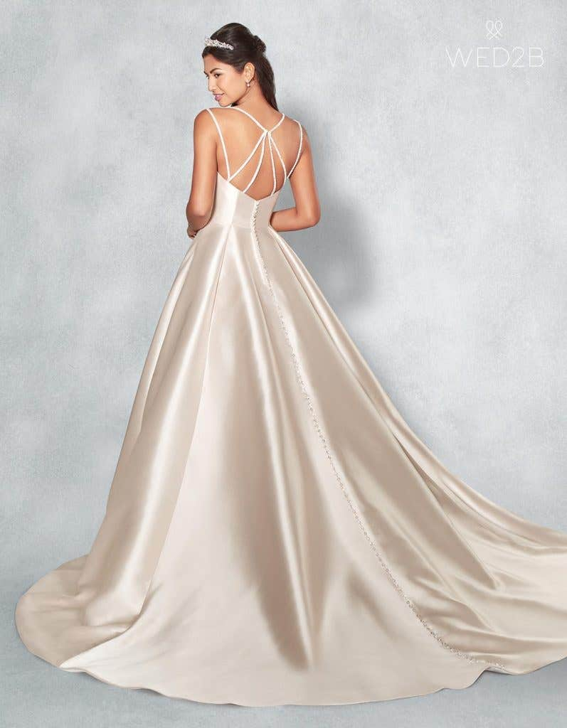 Back view of Amber in blush, a princess wedding dress