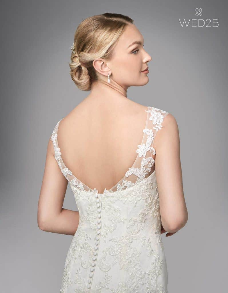 Close-up back view of Andrea, a button back wedding dress