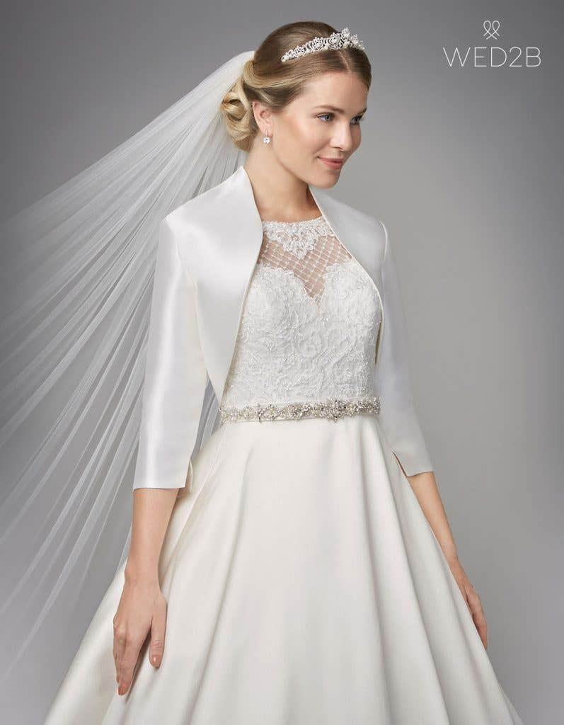 Close-up front view of lace wedding dress Gianna with bridal jacket Monaco