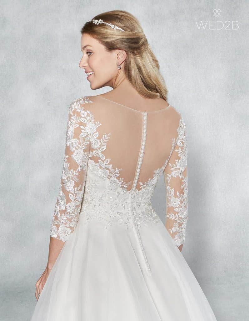 Close-up back view of Holly, a button back wedding dress