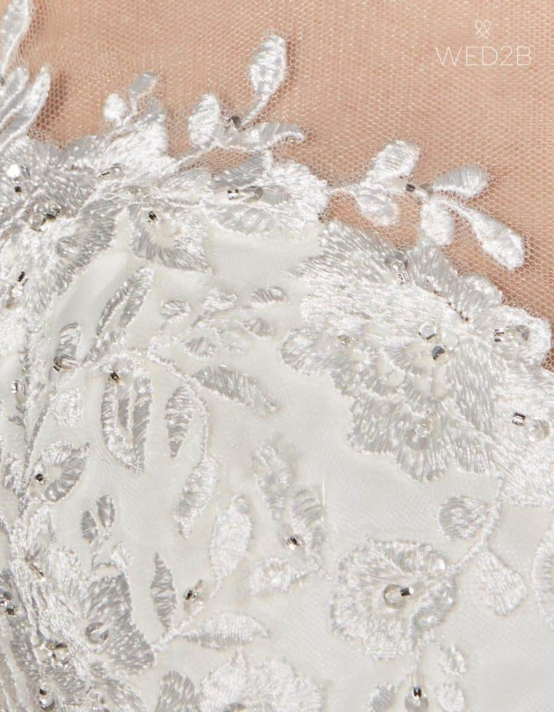 Detailed view of Holly, a button back wedding dress