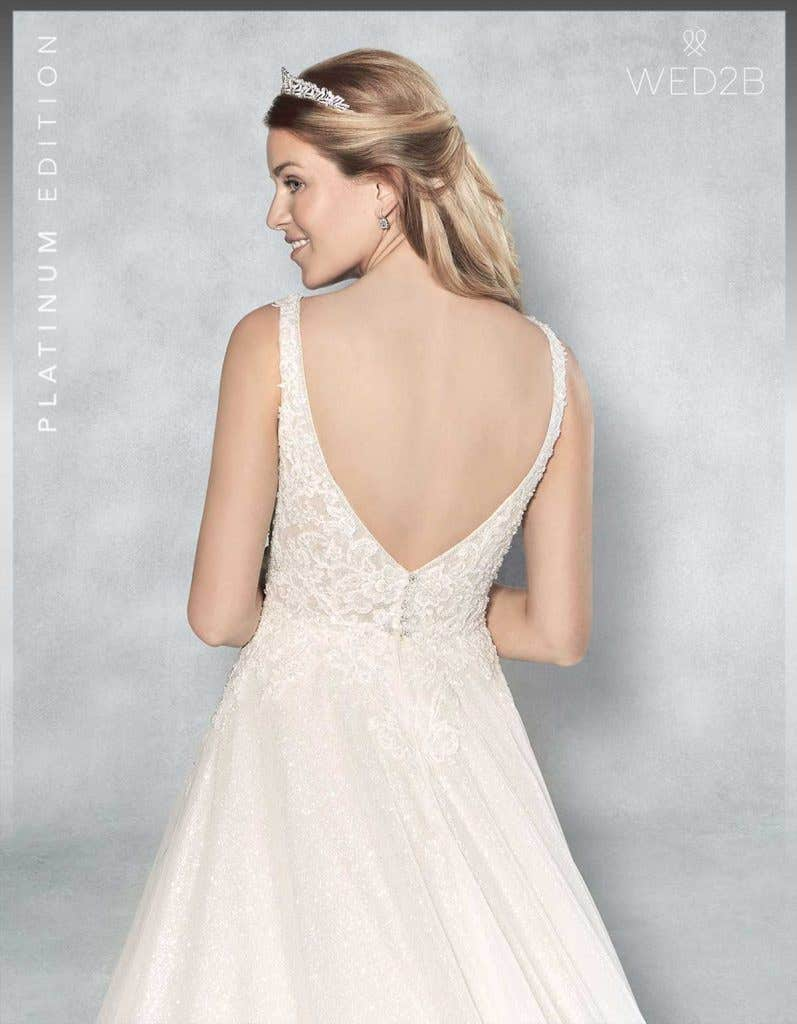 Close-up back view of lace wedding dress Lazara