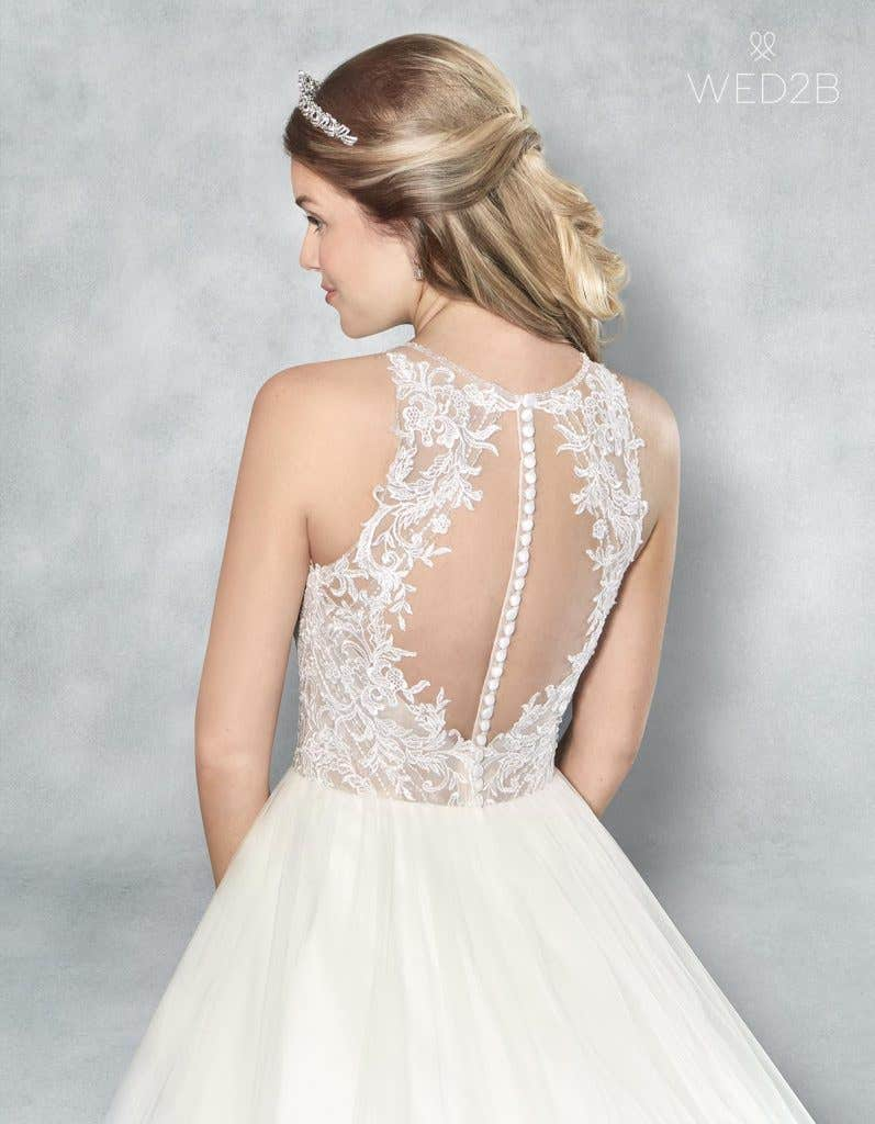 Close-up back view of Presley, a button back wedding dress