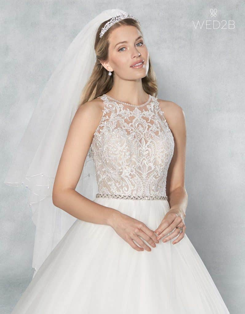 Close-up front view of Presley, a button back wedding dress, with a bridal belt and Willa veil