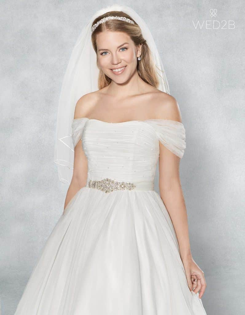 Crop front view of stunning wedding dress Lola with accessories