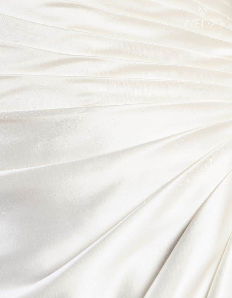 Detail view of wedding dress with straps Emery