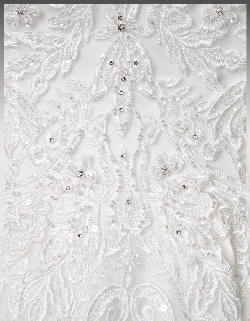 Detail view of wedding dress with straps Karolina